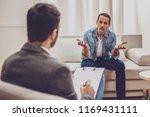 listen to me. serious man... | Shutterstock . vector #1169431111