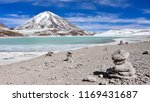 a rock pile stands in front of... | Shutterstock . vector #1169431687