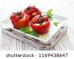 baked  tomatoes stuffed witn... | Shutterstock . vector #1169438647