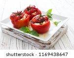baked  tomatoes stuffed witn... | Shutterstock . vector #1169438647