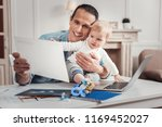 caring father. cheerful... | Shutterstock . vector #1169452027