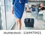 stewardess legs and suitcase in ... | Shutterstock . vector #1169475421
