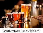 a variety of beer glasses lined ... | Shutterstock . vector #1169496574