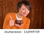 girl drinking tea on a brown... | Shutterstock . vector #116949739