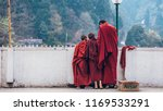 three buddhist monks in purple... | Shutterstock . vector #1169533291