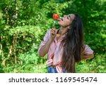 seductive appetite. girl holds... | Shutterstock . vector #1169545474