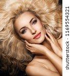 beautiful young woman posing | Shutterstock . vector #1169554321