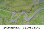 aerial  tourist car drives down ...   Shutterstock . vector #1169575147