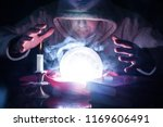 wizard with hood and lights... | Shutterstock . vector #1169606491