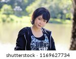 portrait of an asian woman in... | Shutterstock . vector #1169627734