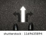 businessman is looking down at... | Shutterstock . vector #1169635894