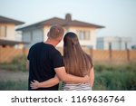 couple looking at they's house | Shutterstock . vector #1169636764