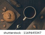 a cup of black tea with cookies. | Shutterstock . vector #1169645347