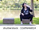 portrait of a beautiful asian... | Shutterstock . vector #1169646814