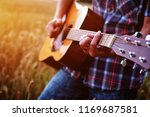 musician playing guitar at... | Shutterstock . vector #1169687581