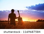 musician with guitar at sunset... | Shutterstock . vector #1169687584