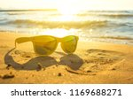 yellow sunglasses on yellow... | Shutterstock . vector #1169688271