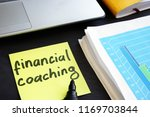 memo stick with words financial ... | Shutterstock . vector #1169703844