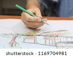 elderly woman painting color on ... | Shutterstock . vector #1169704981