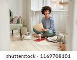 satisfied student works on... | Shutterstock . vector #1169708101
