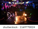 glass with whisky with ice cube ...   Shutterstock . vector #1169770024