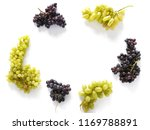 frame of black and green grapes ... | Shutterstock . vector #1169788891