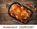 roast christmas duck with thyme ... | Shutterstock . vector #1169812687