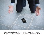 sad businessman after his phone ... | Shutterstock . vector #1169816707