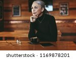 senior businesswoman sitting at ... | Shutterstock . vector #1169878201