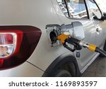 pumping gas at gas pump.... | Shutterstock . vector #1169893597
