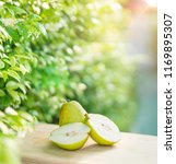 fresh pears on the brown wooden ...   Shutterstock . vector #1169895307