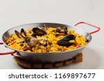 traditional paella with mussels.... | Shutterstock . vector #1169897677