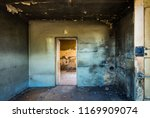 abandoned old dirty room in... | Shutterstock . vector #1169909074