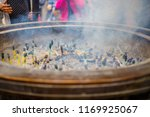 smoke from many burning incense ...   Shutterstock . vector #1169925067