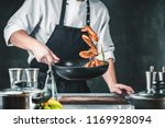 chef cooking with tiger prawn... | Shutterstock . vector #1169928094