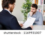 worried job candidate waiting... | Shutterstock . vector #1169931007