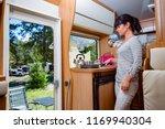 woman cooking in camper ... | Shutterstock . vector #1169940304