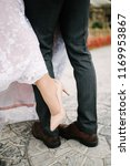 wedding shoes of the bride and... | Shutterstock . vector #1169953867