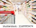 empty shopping cart with... | Shutterstock . vector #1169995474
