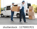 male movers unloading boxes... | Shutterstock . vector #1170001921