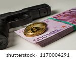 black pistol with a pack of...   Shutterstock . vector #1170004291