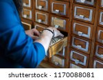 man's hand searching for files... | Shutterstock . vector #1170088081
