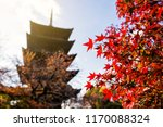 red maple leaf with toji wooden ... | Shutterstock . vector #1170088324