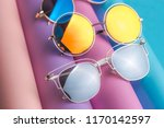 set of colorful sunglasses on... | Shutterstock . vector #1170142597