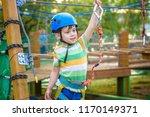 little cute boy enjoying... | Shutterstock . vector #1170149371