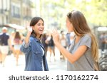 two happy friends meeting and... | Shutterstock . vector #1170162274