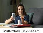 suspicious student comparing... | Shutterstock . vector #1170165574