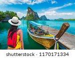 traveler woman looking...   Shutterstock . vector #1170171334