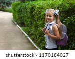 happy cute child girl with... | Shutterstock . vector #1170184027