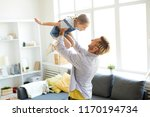 young father raising his... | Shutterstock . vector #1170194734